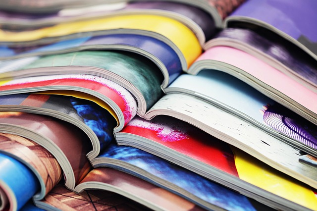 Images of several magazines open on a table